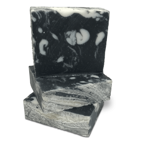Stack of Handmade soap black with activated charcoal best bar soap for bad skin prepared by Caribbean Soaps made in Puerto Rico 4.25 oz.